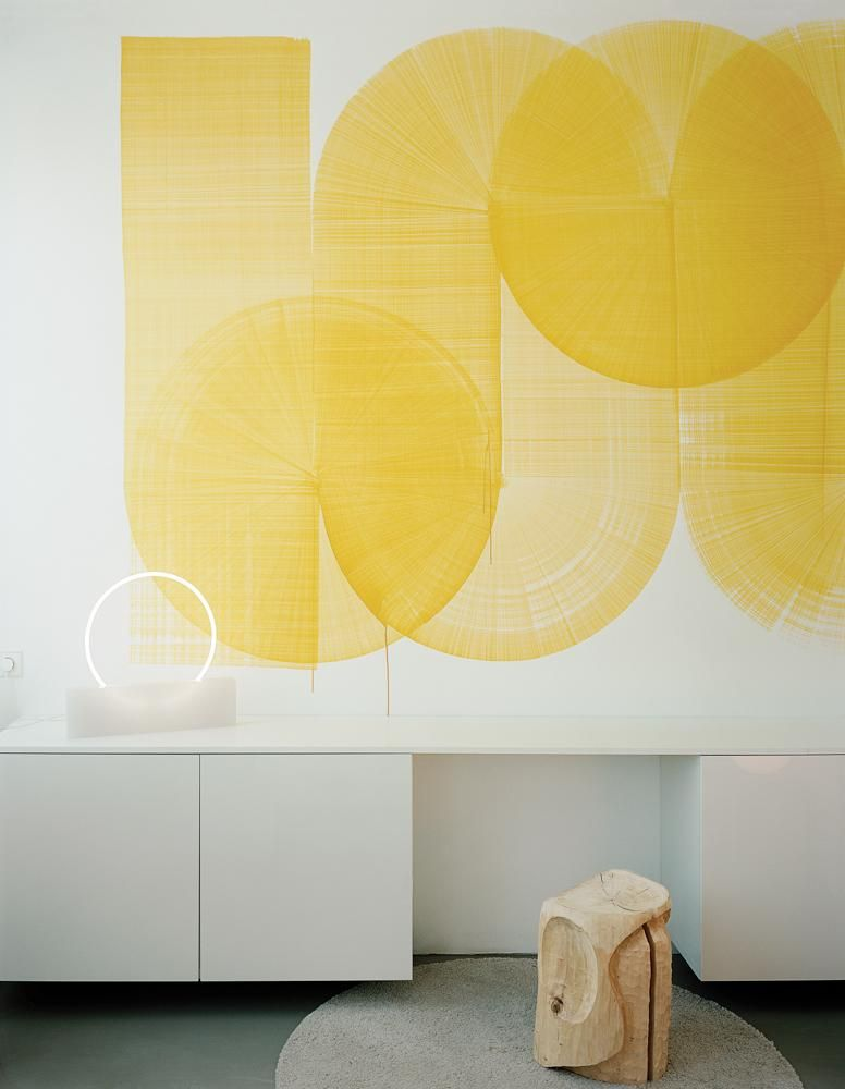 BRIGHT AS YELLOW In the guest room, Marcelis's Voie light with a Thomas Trum wall painting and a FOS stool.