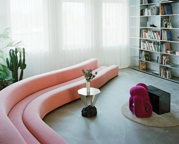 CURVE APPEAL A Pierre Paulin sofa and steel-and-concrete table by FOS in the open living area of Marcelis and Cournet's apartment in the Coolhaven district of Rotterdam.