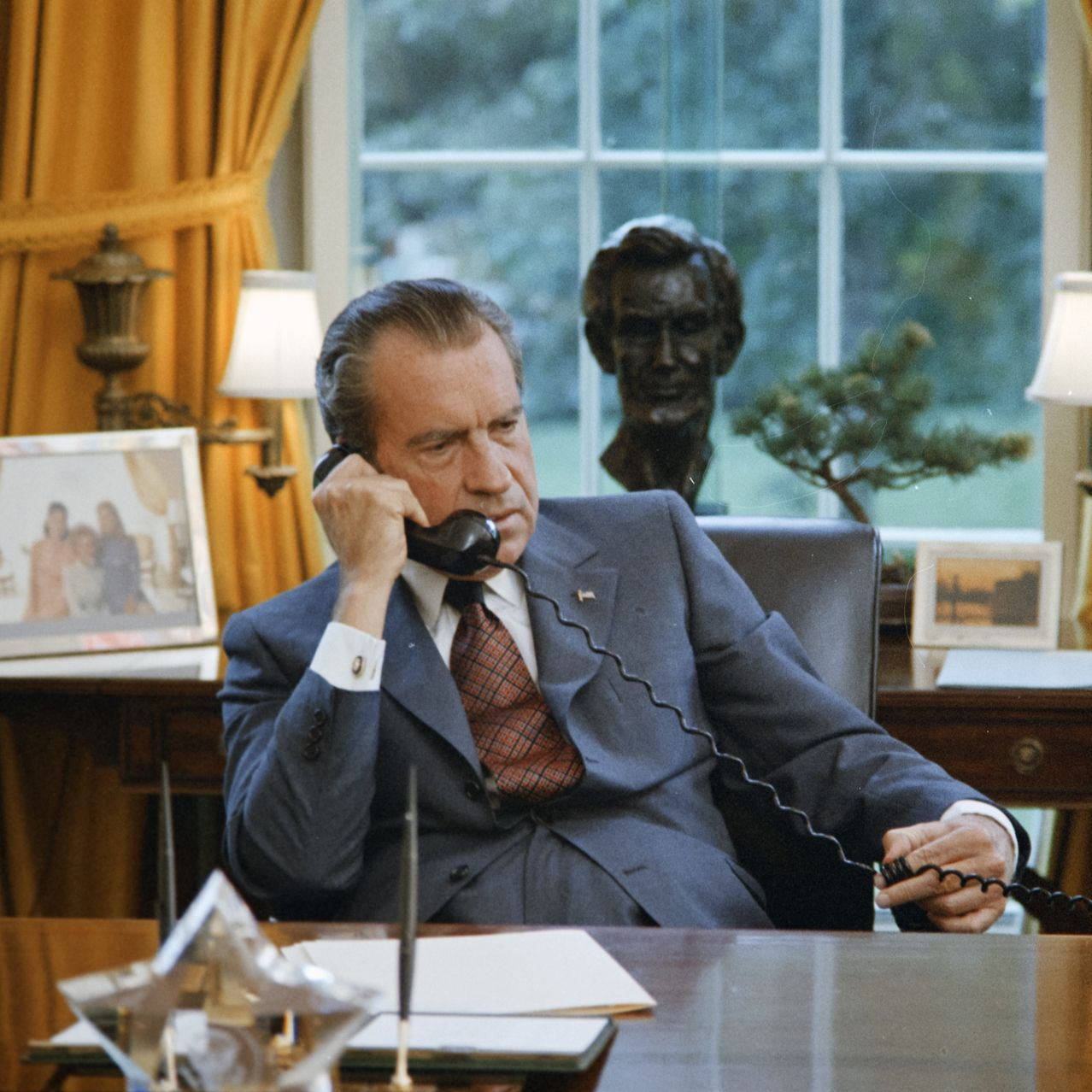 President Nixon at his desk in the White House in June 1972, the month that a break-in at the Watergate complex in Washington unleashed a protracted political scandal.