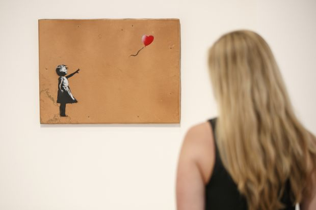 'Girl with Balloon' by Banksy at Lazinc Gallery in London in July