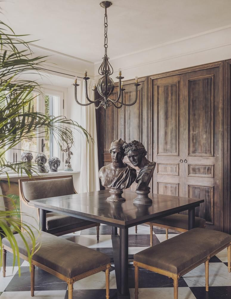 A sculpture-filled dining area, all designed by the firm Gilles & Boissier.
