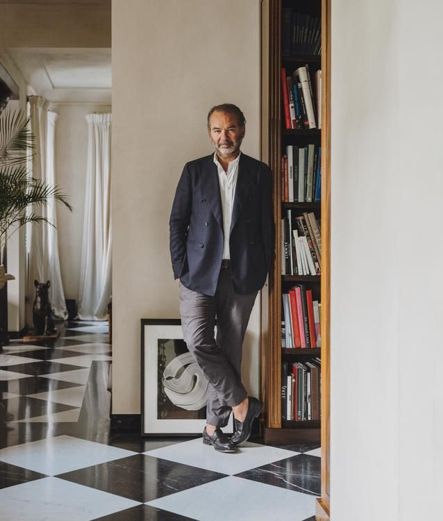 """ITALIAN STYLE Remo Ruffini in his home in Como, Italy. He is forgoing seasonal presentations to bring customers an array of Moncler products in a project dubbed the Genius Building. """"It's a new way to look at fashion,"""" says Valentino's Pierpaolo Piccioli, one of the designers collaborating with Moncler."""