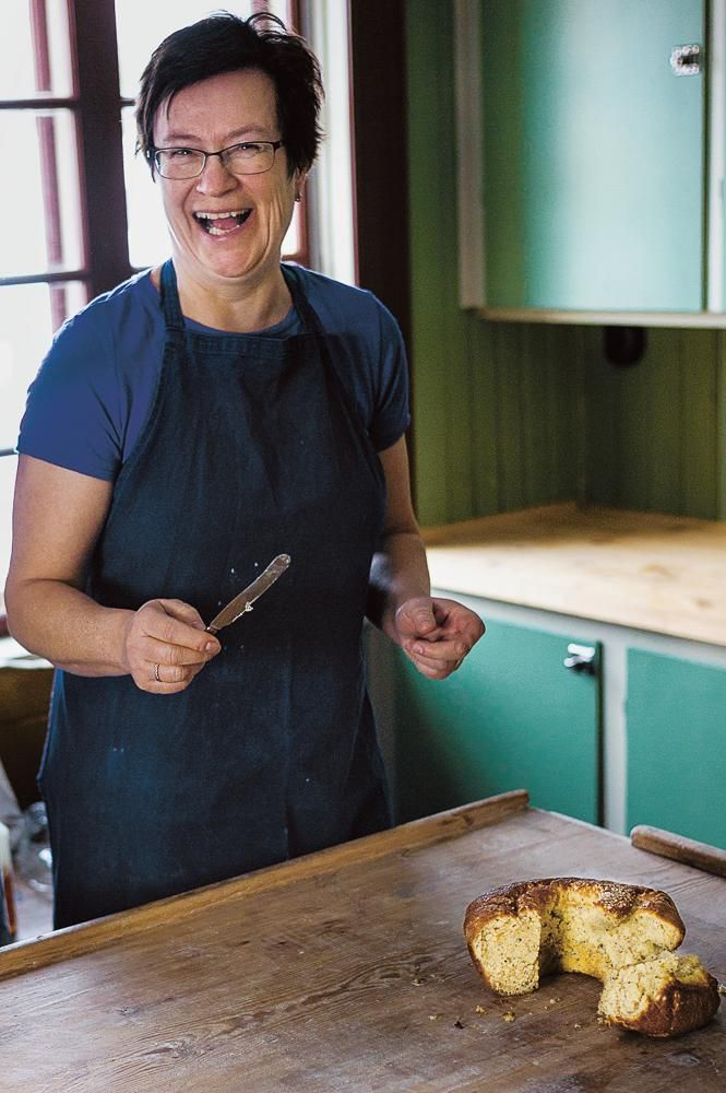 FAMILY MATTERS Nilsson's mother, Anki Lundstedt Nilsson, cutting cardamom cake, winter 2015.