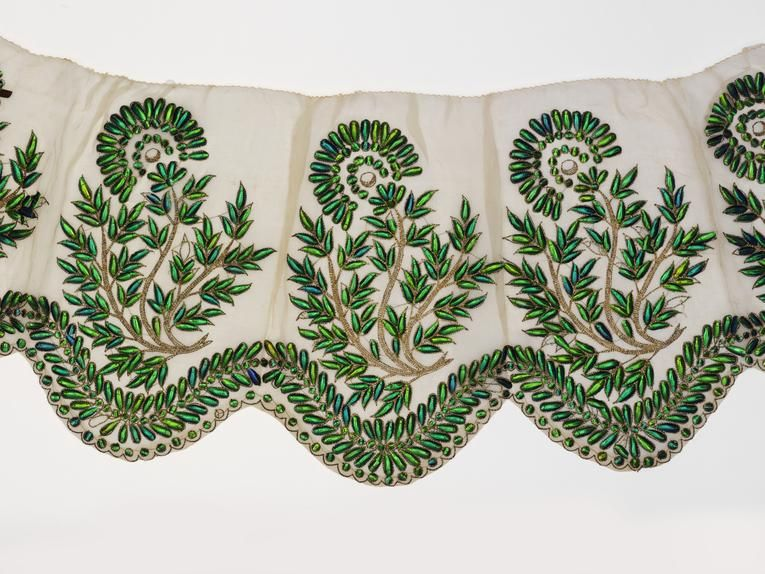 Detail of a border for a dress made with the shell-casings of jewel beetles (c. 1850)