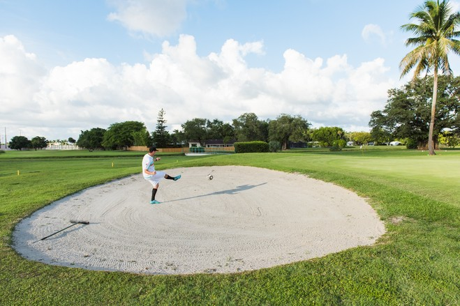 Mr. Bicerne kicks the ball out of a sand trap. His passion for FootGolf motivated him to shed 40 pounds. He was recently named captain of the U.S. FootGolf Team and will play in the 2018 Footgolf World Cup in Marrakesh.