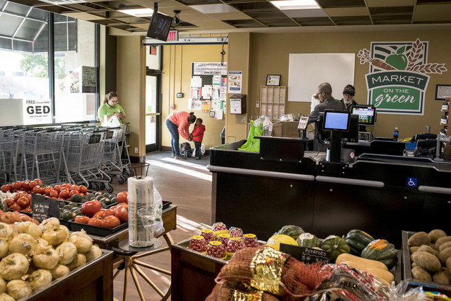 Market on the Green, a grocery store that ProMedica runs in Toledo, Ohio, tries to steer shoppers toward healthful fare.