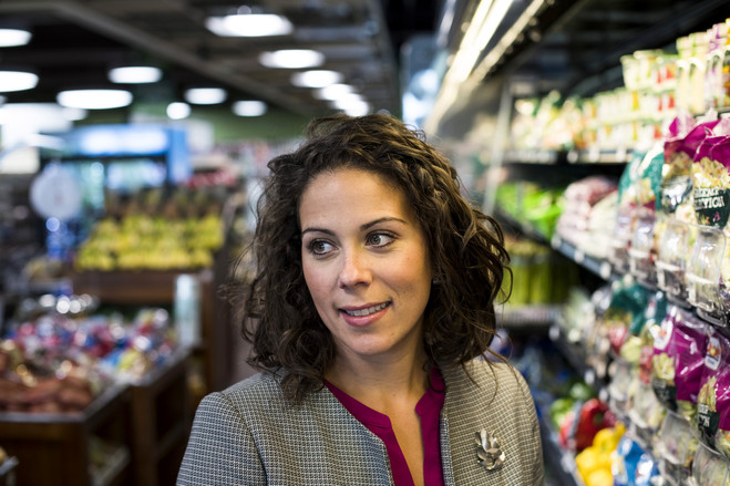 ProMedica executive Kate Sommerfeld tries to nudge shoppers at Market on the Green to nutritious offerings.