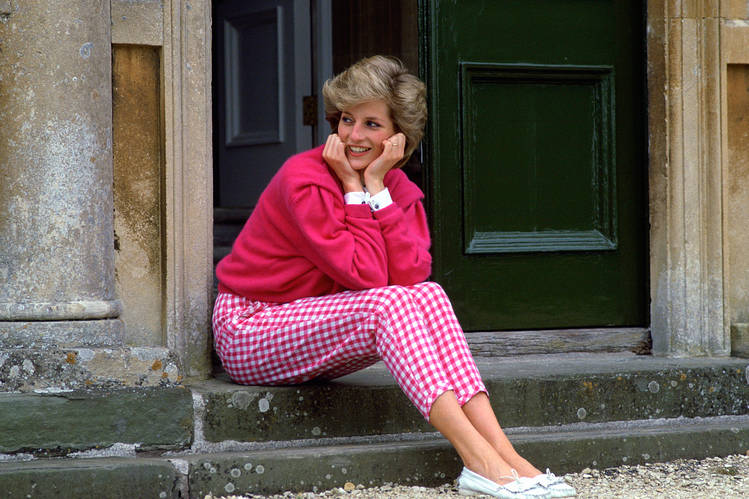 GINGHAM PALACE Her Royal Highness posing on the steps of her Highgrove home in 1986.