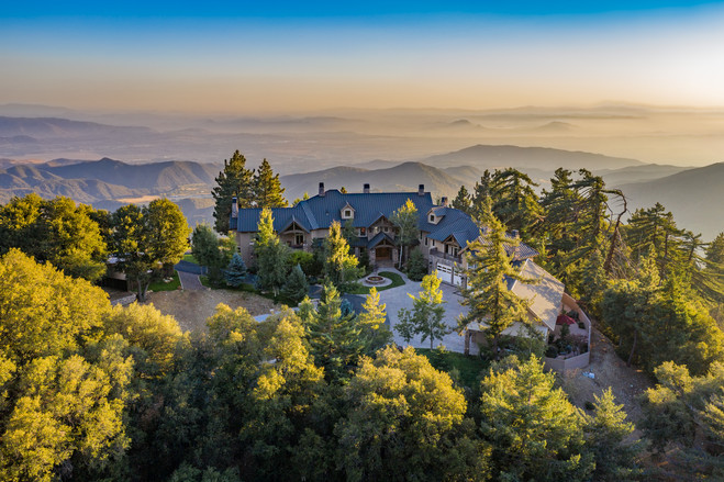Rick Knudsen said he used to look up at this home from his porch, wondering what it would be like to live there. After winning $180 million in the lottery, he purchased the home.