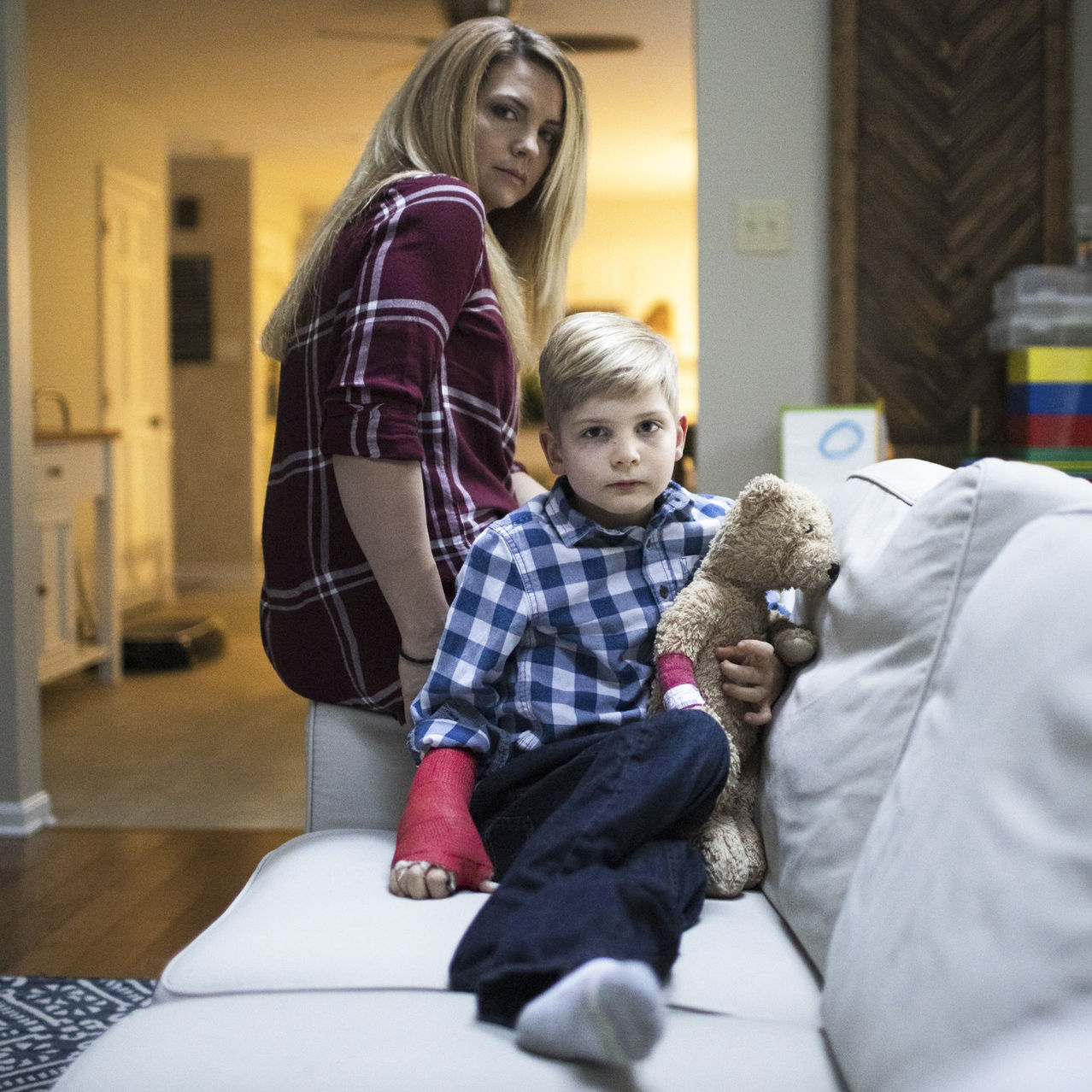 Christa Bottomley sits in her York, Pa., home with her 7-year-old son, Sebastian, who remains partially paralyzed after a common viral cold he had two years ago triggered a rare neurological condition called acute flaccid myelitis, or AFM.