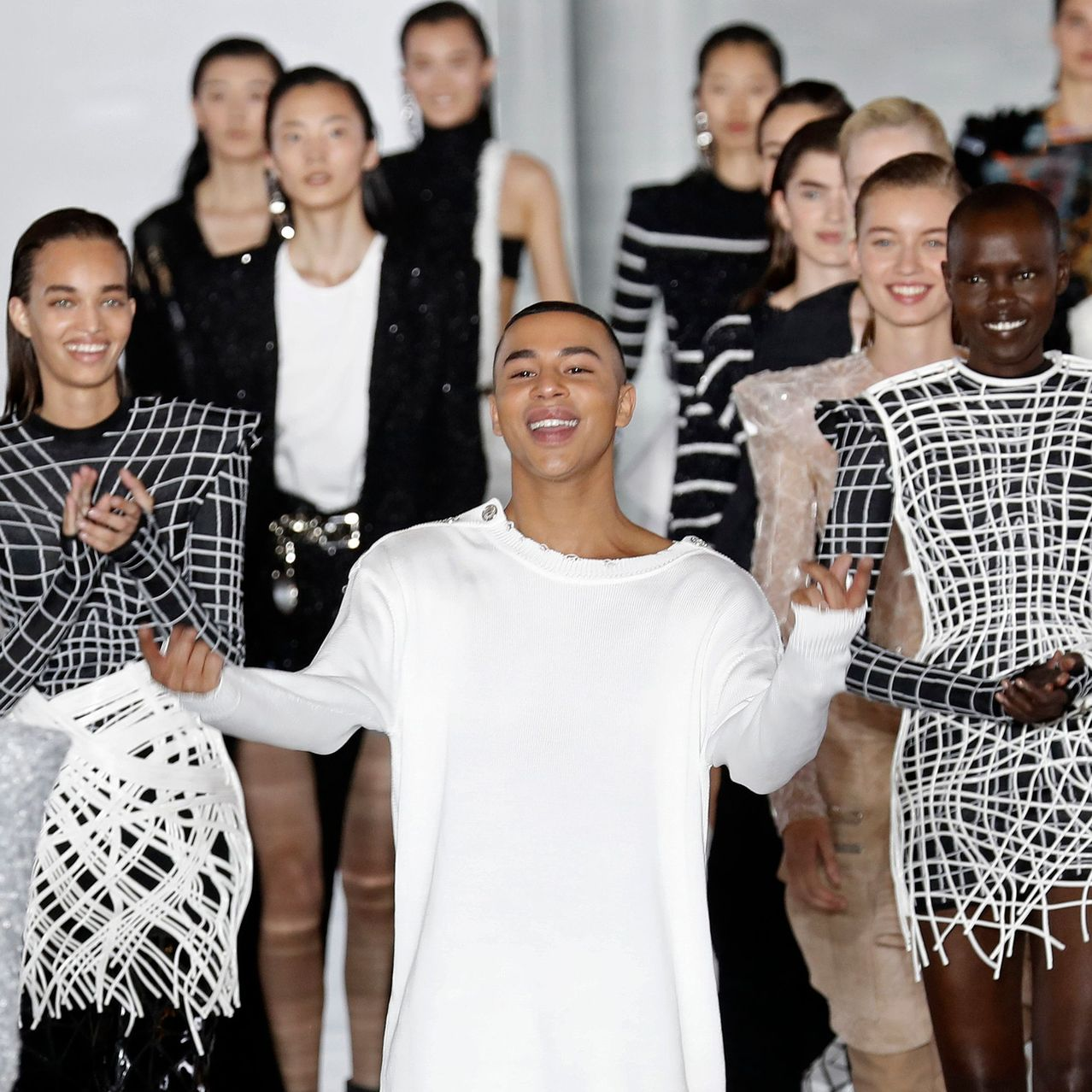 Olivier Rousteing, center, greeted the crowd at a Balmain fashion show in Paris in September.