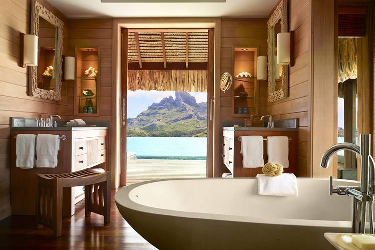 A one-bedroom mountain-view overwater suite at Four Seasons Resort Bora Bora.