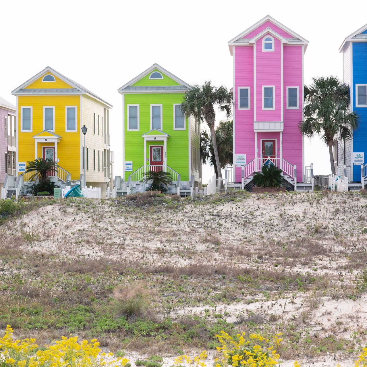 A colorful row of seaside homes along the Gulf of Mexico are know to local as 'The Skinnys,' on barrier Island Saint George.
