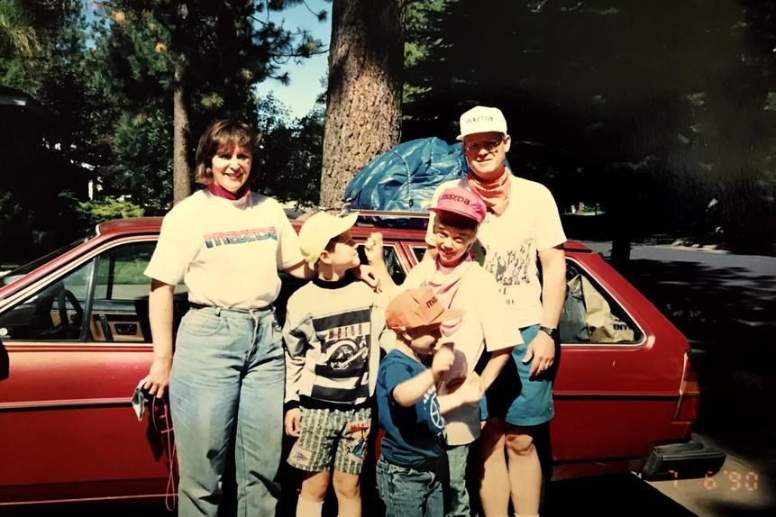 """'One of our family's favorite episodes was Season's One's """"The Call of the Simpsons,"""" in which Homer buys an RV and gets the family lost in the woods,' says Chris Kornelis, second from left, in a 1990 photo. 'Here, we're on our own family road trip in the trees.'"""