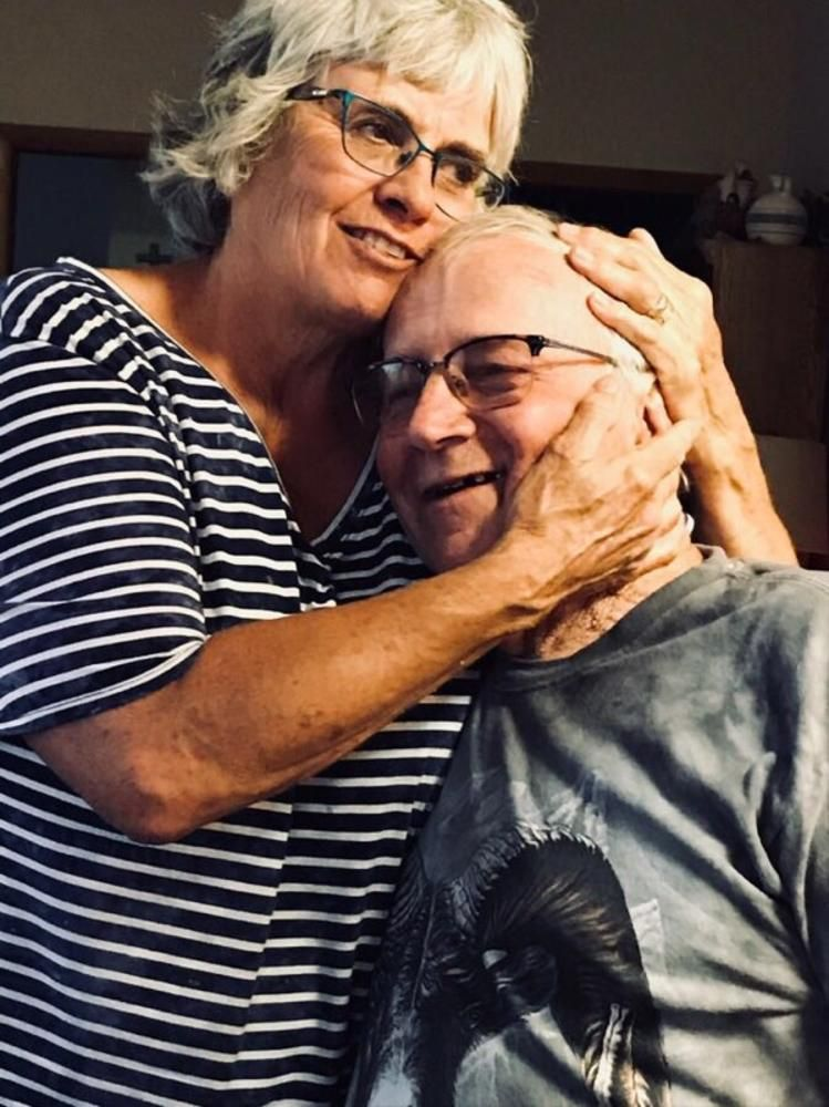 Patti Jo Baker, who cares for her husband, Larry, a retired diesel mechanic with Alzheimer's disease, worries that moving from their familiar home in Wyoming would make things worse for him.