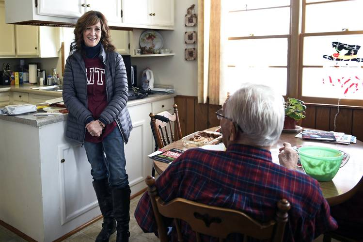 Janine Moris, a volunteer with Faith in Action, visits with Roger Jaster before driving his wife, Bev, from Cavalier, N.D., to Grand Forks—an 180 mile-round trip—for dialysis treatment.