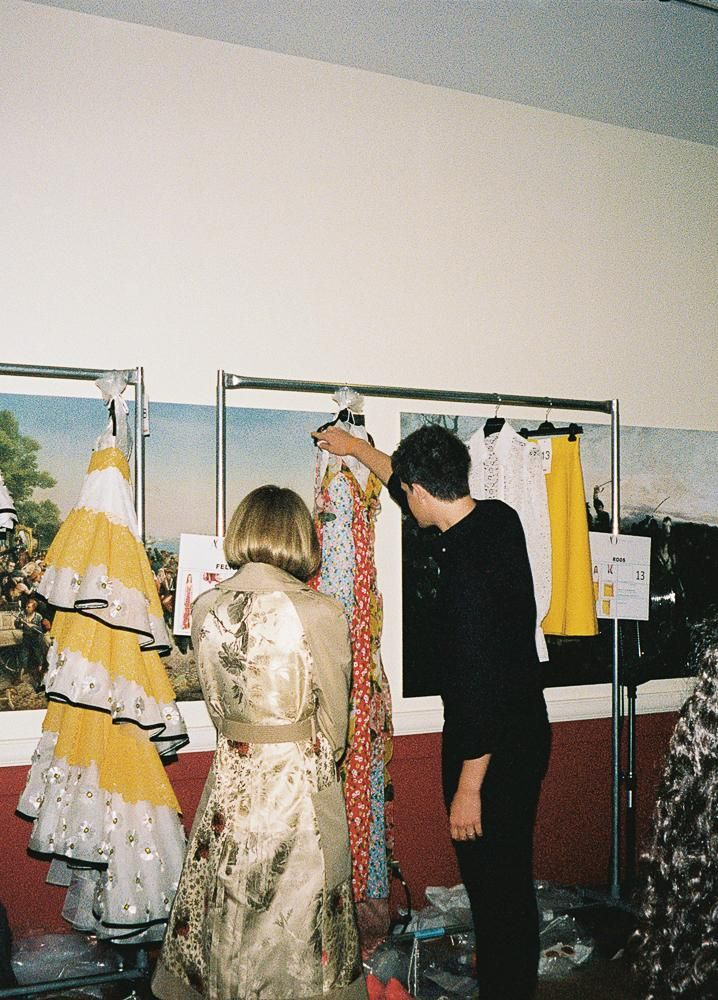Anna Wintour reviews the collection with Gordon.
