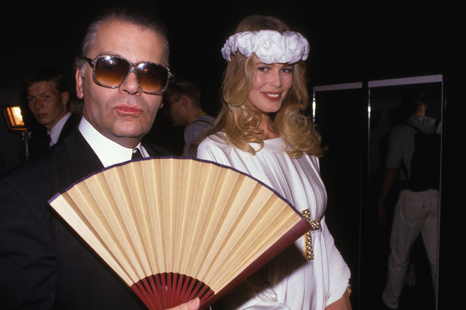 Mr. Lagerfeld and Claudia Schiffer at a Chanel haute-couture show in Paris in July 1990. The designer, whose career also included work for Fendi, Chloe and other storied houses, became a celebrity in his own right.