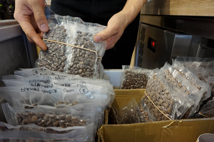 Premium coffee beans are sealed in air-tight pouches in a freezer at the ONA Coffee cafe in Sydney, Australia.