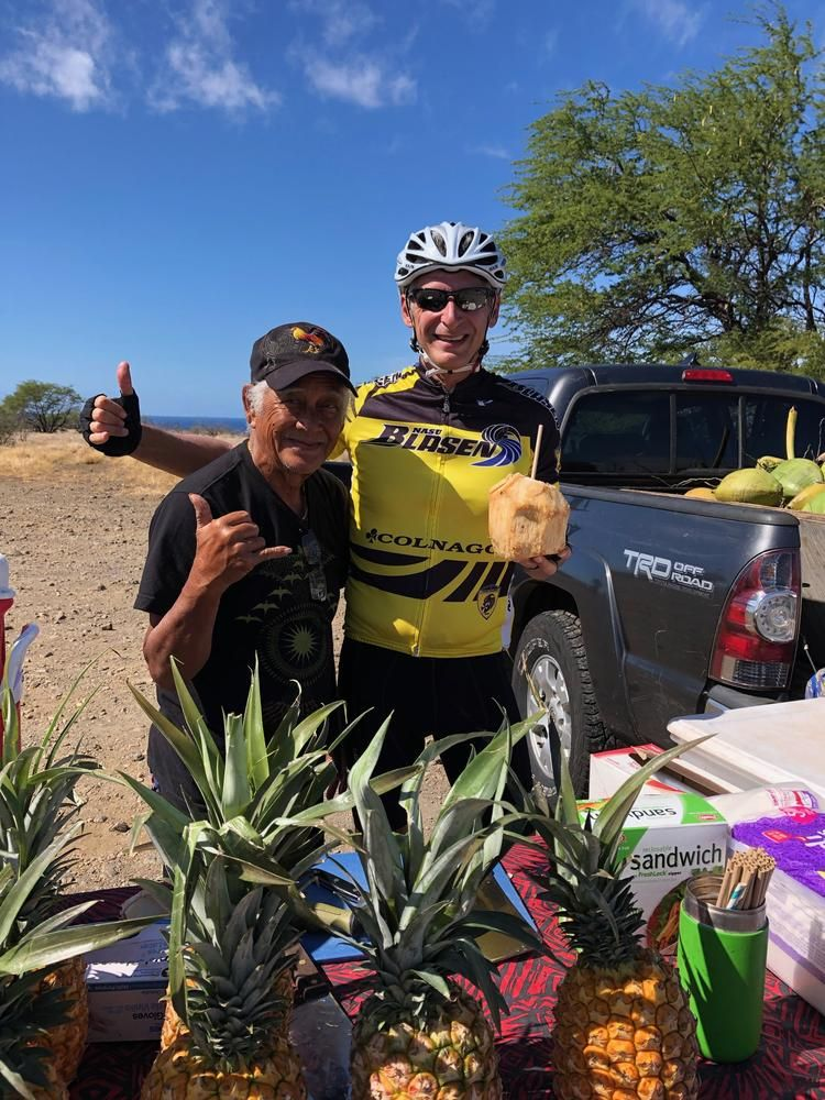 The author (right) at a fruit stand in South Kohala.