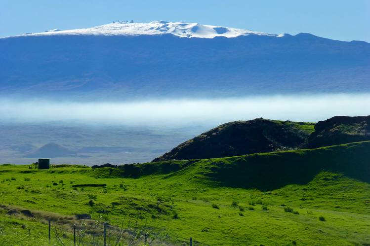 Mauna Kea in winter, as seen from Kohala Mountain Road, where the author ended his five-day cycling trip.