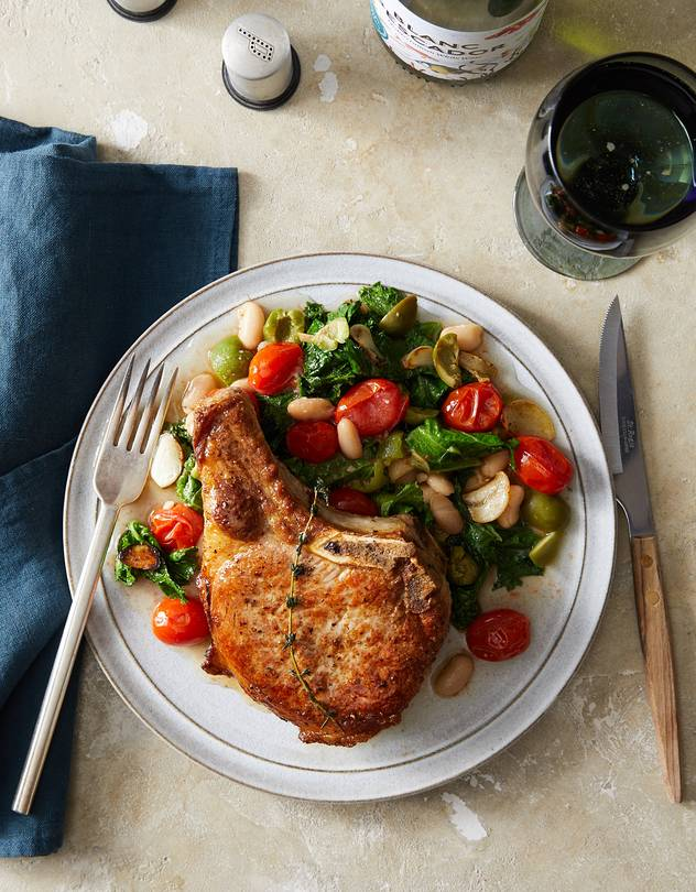 FINISH BIG Basting with brown butter infused with garlic and herbs helps put an even, flavorful sear on the pork chops.