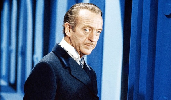 Casino Royale 1967 David Niven looking concerned in a blue hallway