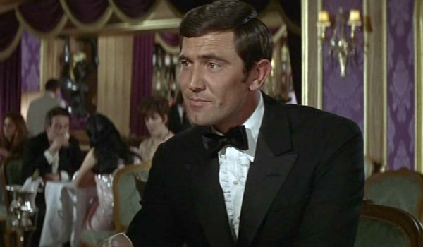 On Her Majesty's Secret Service George Lazenby enjoying a conversation seated in a restaurant
