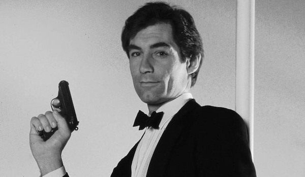 The Living Daylights Timothy Dalton poses casually with his gun in the air