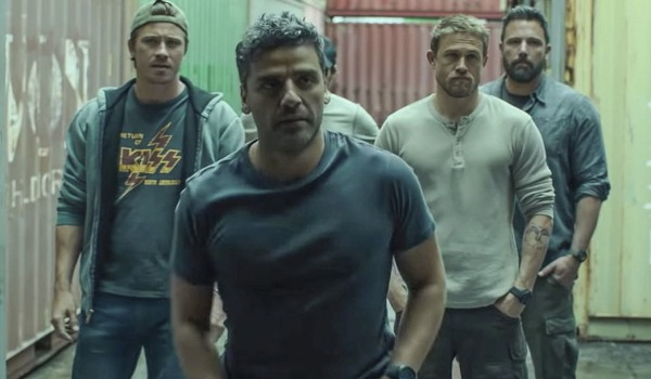 Triple Frontier Garrett Hedlund Oscar Isaac Charlie Hunnam and Ben Affleck looking into a storage co