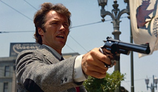 Dirty Harry Clint Eastwood pointing his gun off camera