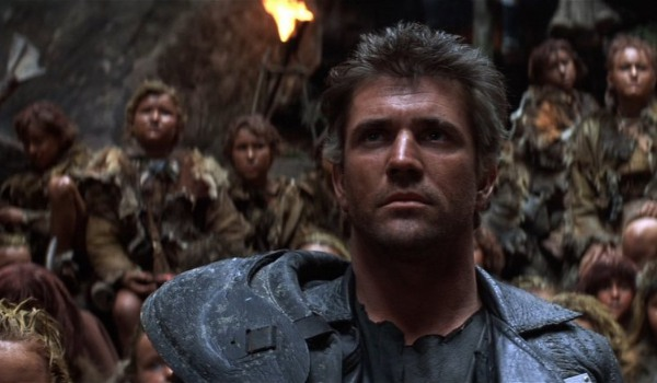 Mad Max Beyond Thunderdome Mel Gibson stands defiant in front of the children