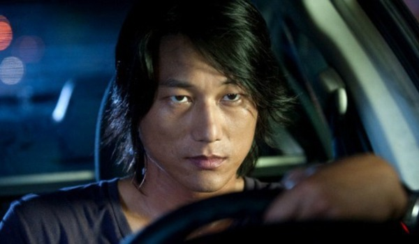 The Fast and The Furious: Tokyo Drift Han scowling behind the wheel of his car