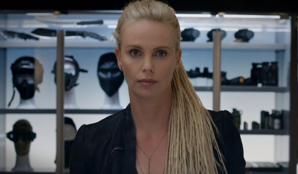 The Fate of The Furious Cipher standing in front of her arsenal, with a really creepy stare