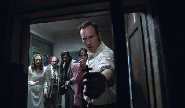 Ed and Loraine Warren look into a closet in The Conjuring 2