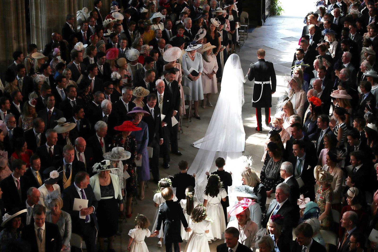 Prince Harry and Meghan Markle leave St George's Chapel in Windsor Castle after their wedding on May 19 2018 in Windsor...