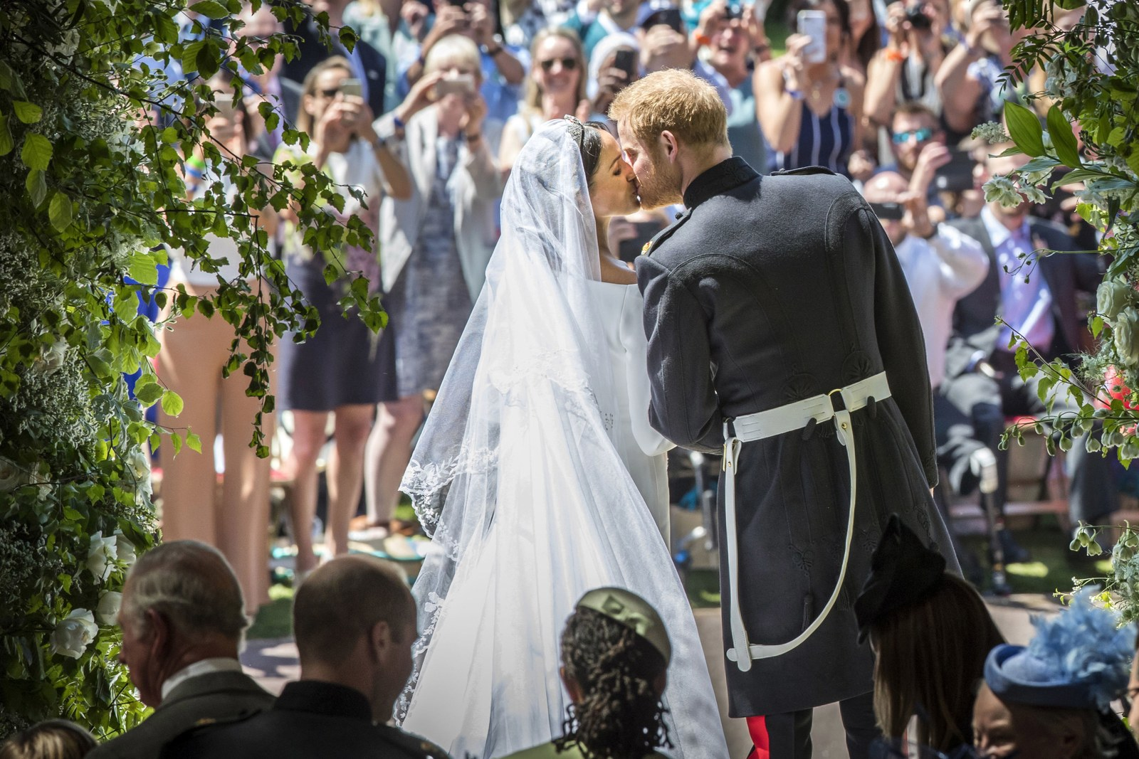 Prince Harry and Meghan Markle kiss on the steps of St George's Chapel in Windsor Castle after their wedding in St...