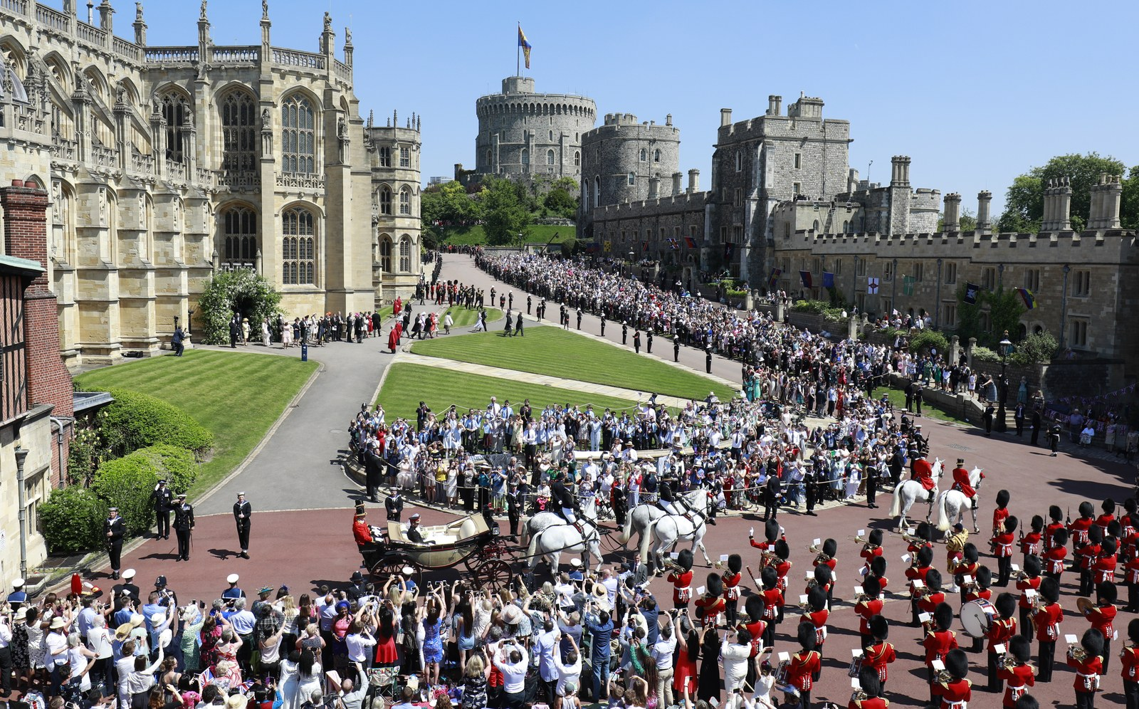 Prince Harry Duke of Sussex and The Duchess of Sussex leave Windsor Castle in the Ascot Landau carriage during a...