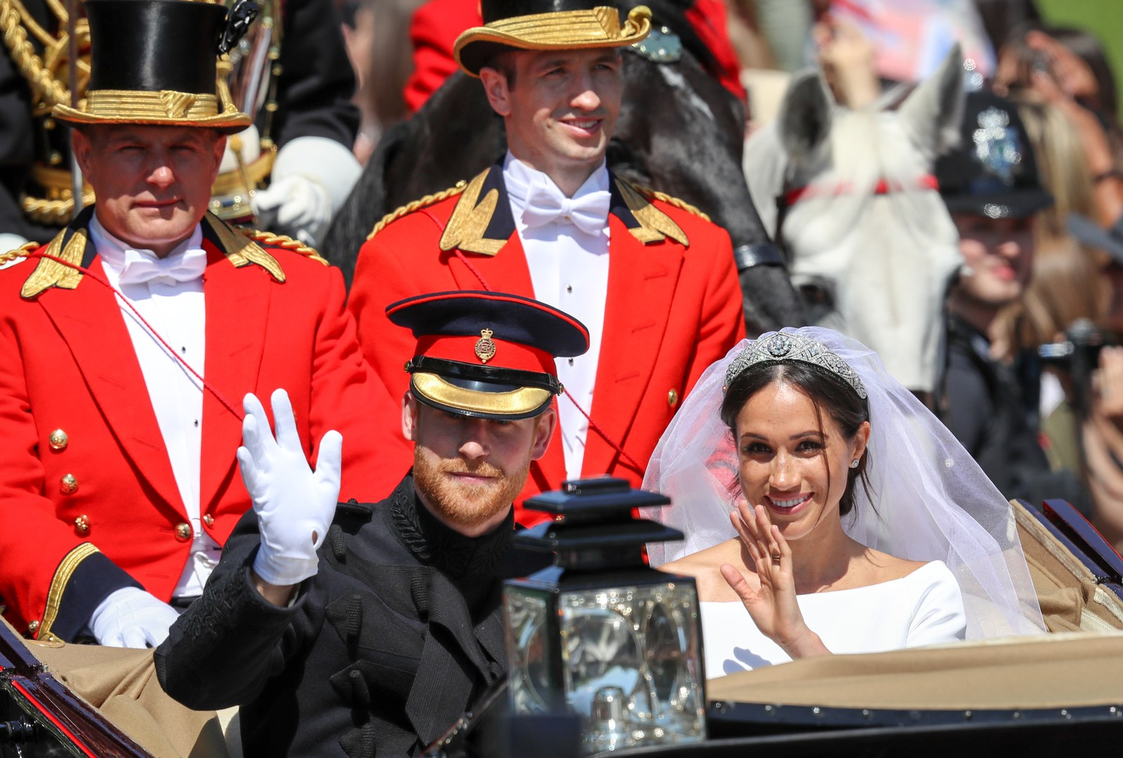 Prince Harry Duke of Sussex and the Duchess of Sussex in the Ascot Landau carriage during the procession after their...