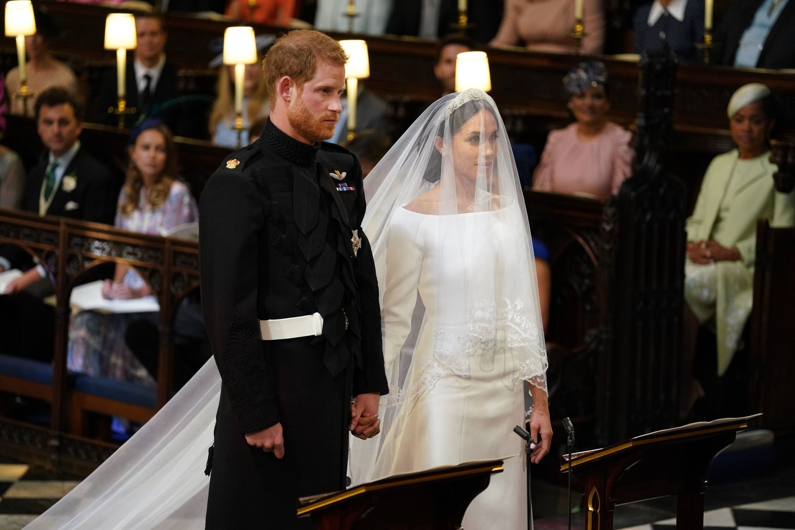 Prince Harry and Meghan Markle stand together in St George's Chapel at Windsor Castle for their wedding on May 19 2018...