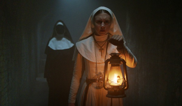 The Nun Valak stalks a young nun in a dark hallway
