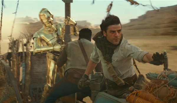 Star Wars: The Rise of Skywalker C3P0, Finn, and Poe speeding away in the desert