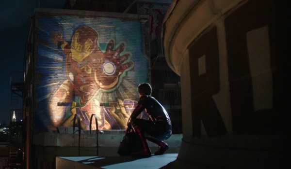 Spider-Man: Far From Home Peter in front of a massive Iron Man tribute mural