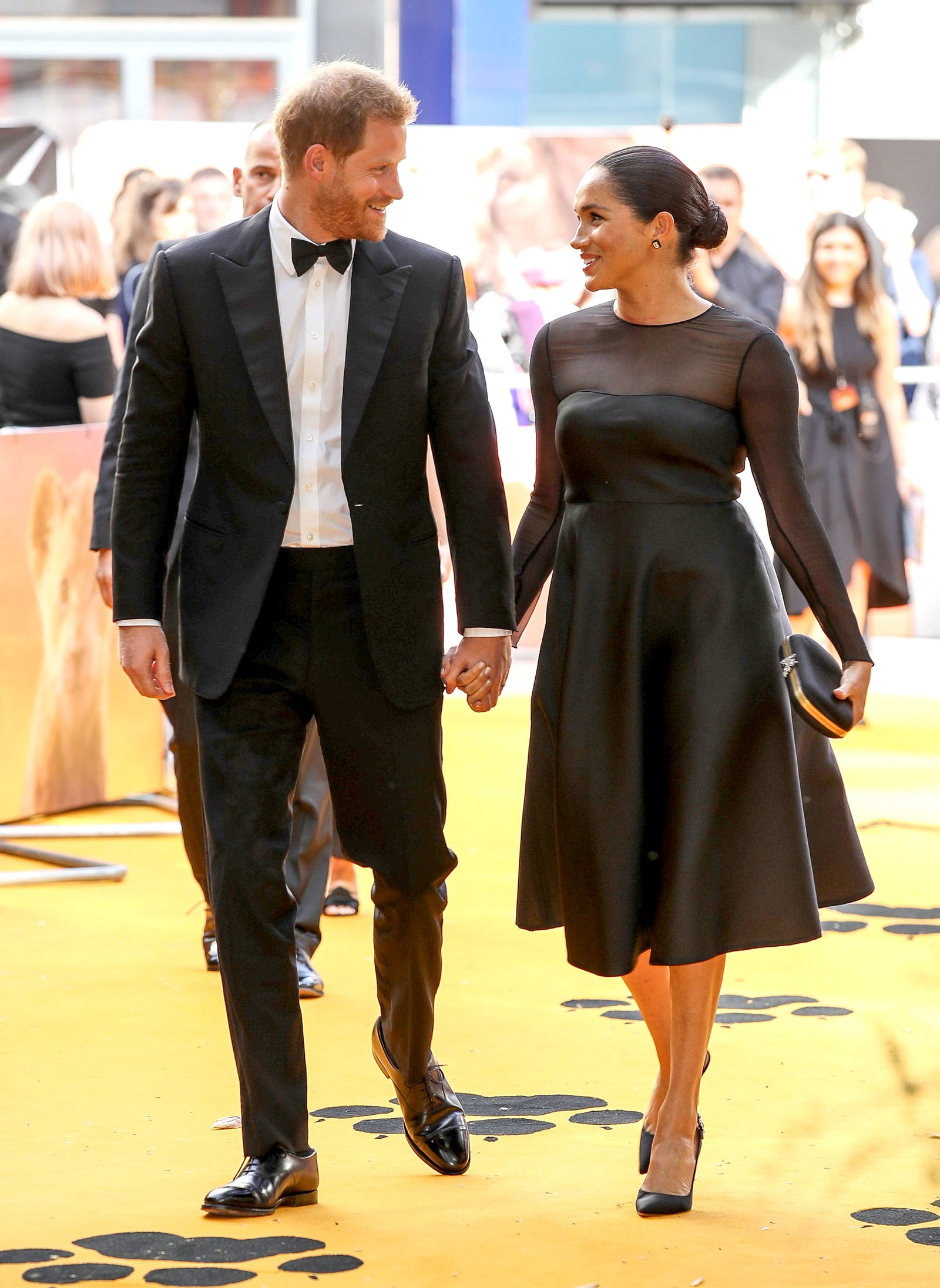 Prince Harry Duke of Sussex and Meghan Duchess of Sussex attend The Lion King European Premiere at Leicester Square on...