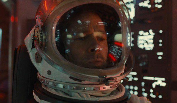 Ad Astra Brad Pitt surrounded by buttons and instrument panels in his spacecraft