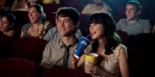 Joseph Gordon-Levitt and Zooey Deschanel enjoying a movie in 500 Days of Summer