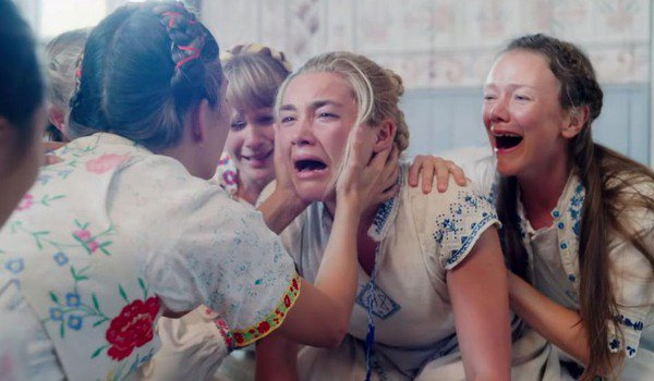 Midsommar Florence Pugh in painful anguish, among the local women