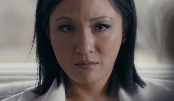 Hustlers Constance Wu looks towards the camera with disdain