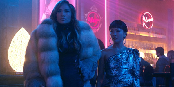Hustlers Jennifer Lopez and Constance Wu preparing for a con at the strip club