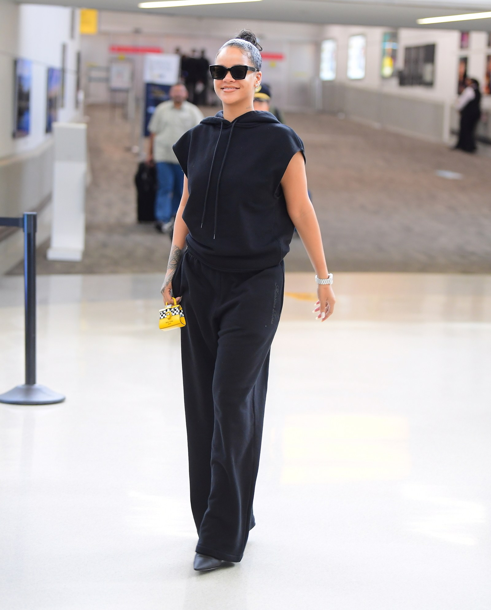 Rihanna Lands in New York for Fashion Week and Her Only Carry on is a Tiny Micro Purse